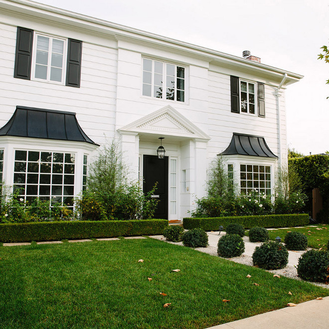 White home exterior with black shutters paint color, Classic White exterior with black shutters paint color, White home exterior with black shutters paint color ideas #Whiteexterior #Whitehome #Whitehomeexterior #WhitehomeexteriorPaintColor #blackshutters blackshutterspaintcolor Waterleaf Interiors