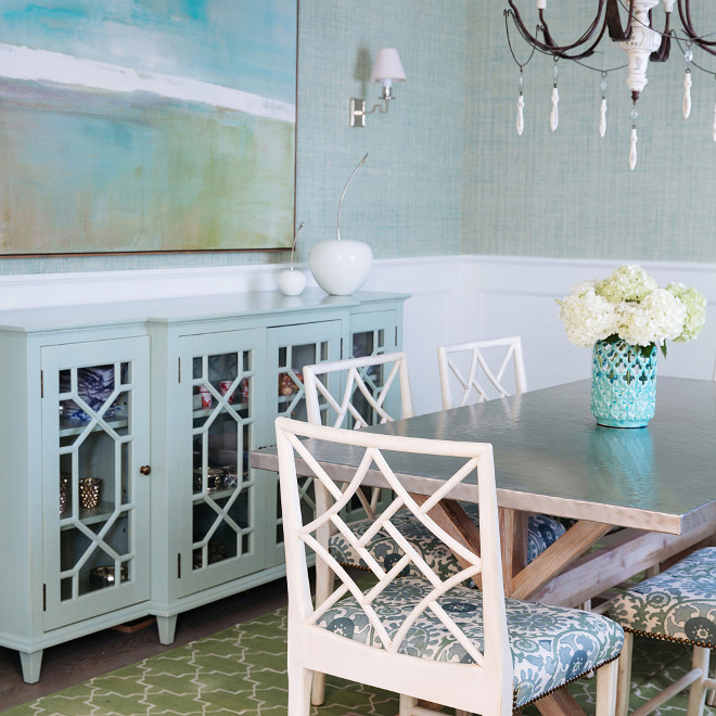 Turquoise Sideboard accented with trellis glass doors, Dining room with Turquoise Sideboard accented with trellis glass doors, blue grasscloth wallpaper and white waiscoting on walls #Diningroom #turquoisesideboard #sideboard #trellis #grasscloth #wainscoting Waterleaf Interiors