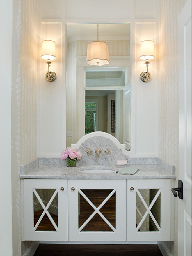 Bathroom mirrored vanity, A gorgeous mirrored vanity with marble countertop and wall mount bathroom faucet are the showstopper features of this powder room Bathroom mirrored vanity ideas, Bathroom mirrored vanity photos, Bathroom mirrored vanity #Bathroom #mirroredvanity #Bathroommirroredvanity Divine Custom Homes Bria Hammel Interiors