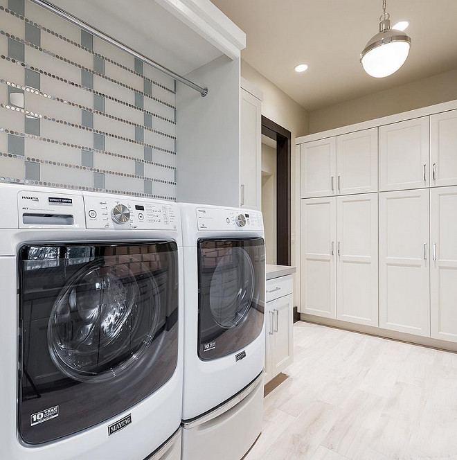 Laundry Tiles. Laundry room tile ideas. Laundry room features glass tile and stainless penny round combo. Laundry Room Tiling. #Laundryroom #LaundryroomTiles #LaundryroomTileCombo #LaundryroomTileIdeas #LaundryroomTiling Sita Montgomery Design