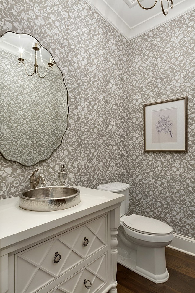 "This charming powder room features a gorgeous custom vanity painted in ""Benjamin Moore White Dove"" and a gray and white floral wallpaper Gray and white Floral Wallpaper, Small bathroom with gray and white floral wallpaper and white vanity #Bathroom #Floral #Wallpaper #GrayWallpaper #Grayandwhite #grayandwhitewallpaper #bathroomwallpaper #smallbathroom"