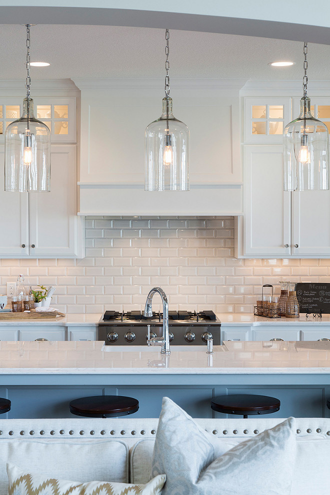 Beveled Subway Tile Backsplash. White kitchen cabinets with white countertop combining with Beveled Subway Tile Backsplash. Beveled Subway Tile Backsplash #BeveledBacksplash #WhiteBeveledBacksplash #WhiteBeveledTile #KitchenBeveledTileBacksplash Spacecrafting Photography.
