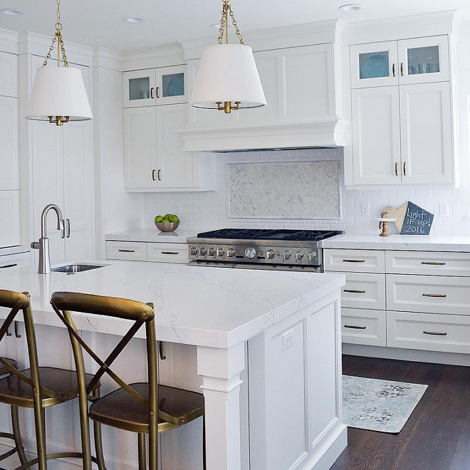Kitchen white quartz countertop. Kitchen with thick white countertop. This kitchen features island and perimeter counters in Pental Quartz in Avenza. #PentalQuartz #AvenzaQuartz #Kitchenwhitequartz #whitequartz #thickquartzcountertop Sita Montgomery Design