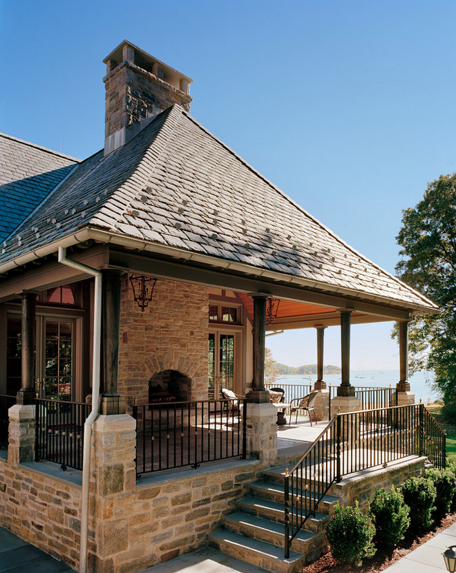 Outdoor Rooms, Well-suited for outdoor entertaining, the Family Room Porch is outfitted with a fireplace and cedar cathedral ceiling supported by reverse taper columns of solid reclaimed timber #OutdoorRooms Douglas VanderHorn Architects