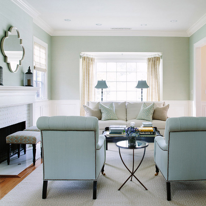 Light blue grasscloth wallpaper, Living room with Light blue grasscloth wallpaper and light turquoise, aqua decor and furniture - White and blue living room features upper walls with light blue grasscloth wallpaper and lower walls clad in wainscoting #Lightbluewallpaper #Lightbluegrassclothwallpaper #grassclothwallpaper #Turquoise #Aqua #wainscoting #livingroomwainscoting #wallwainscoting Waterleaf Interiors