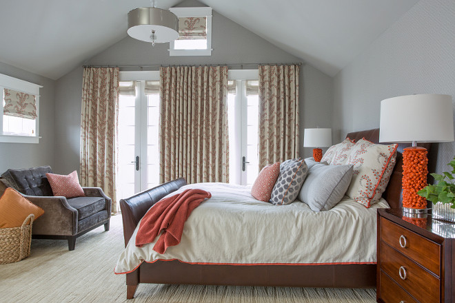 A master suite in gray and orange Walls were covered in a subtle geometric gray on gray wallpaper to act as a backdrop #Masterbedroom #Grayorange #geometricgraywallpaper #geometricwallpaper Alexandra Rae Design