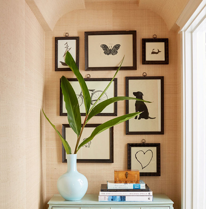 Tan Grasscloth wallpaper, Linen look grasscloth wallpaper, Hallway features tan grasscloth wallpaper with an art gallery over a turquoise blue chest #tangrasscloth #grassclothwallpaper Waterleaf Interiors