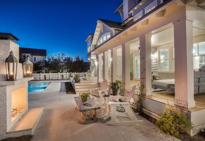 Backyard with large porch, outdoor fireplace and pool. #Backyardideas #backyard 30avibe Photography.