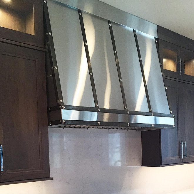 Custom Kitchen Hood. Custom stainless hood with kitchen with dark cabinets. #CustomHood #CustomStainlessHood #Kitchen #Kitchencabinets Cameo Homes Inc. Sita Montgomery Design