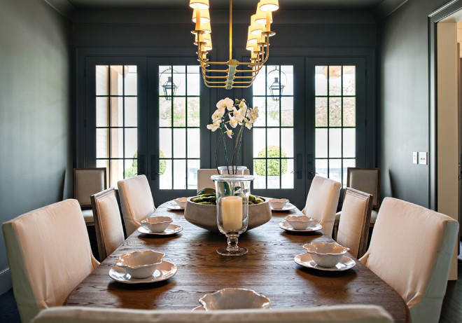 Dark Gray Dining Room Dining room painted in dark gray Lightning is 10 light Linear Pendant from the E.F. Chapman Branched Chandelier #Darkgray #DiningRoom #darkgraydiningroom Allard Ward Architects