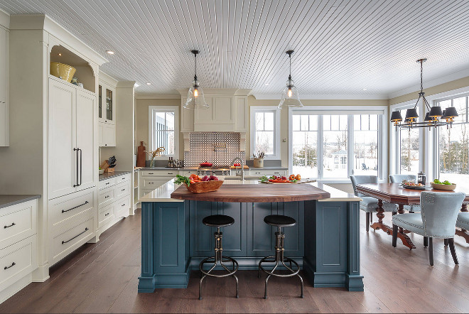 Farmhouse kitchen with blue island This elegant farmhouse kitchen includes a beautiful blue statement island #FarmhouseKitchen #blueisland #bluekitchenisland #Farmhousekitchenisland Astro Design Centre
