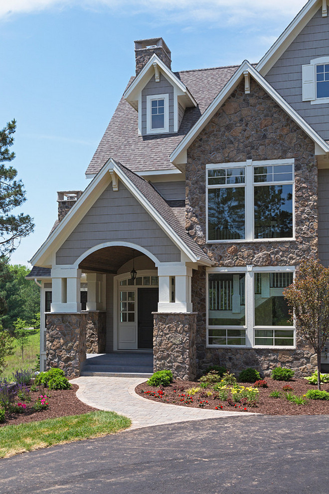 Fieldstone Exterior design ideas and photos, Fieldstone Home Exterior design ideas and photos, Gray Home siding with Fieldstone Exterior #Fieldstone #FieldstoneHomes #FieldStoneExterior Divine Custom Homes
