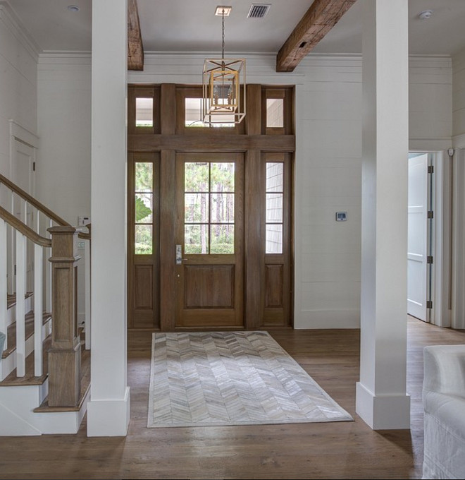 Foyer exposed wood beams and shiplap walls. Foyer exposed wood beams and shiplap walls painted in White Dove by Benjamin Moore. 30A Interiors