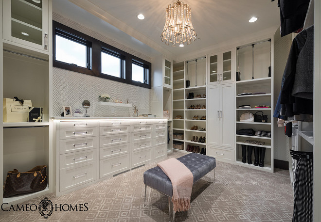 Hers Master Closet with white cabinet and custom dresser with lucite pulls. #Closet #Herscloset #Closetdesign #dressingroom Cameo Homes Inc.