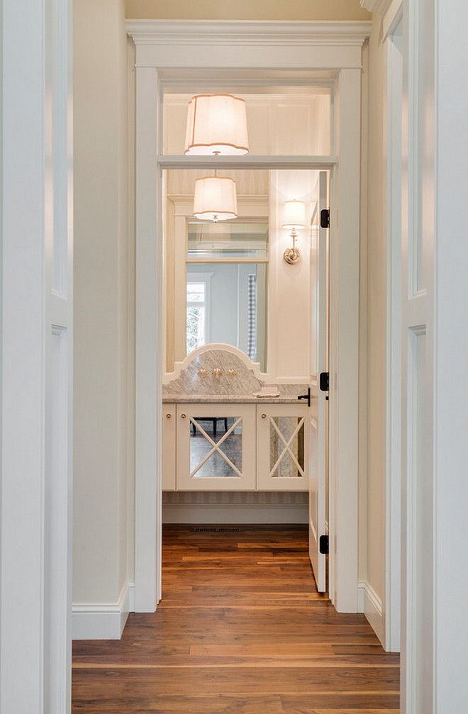 Main Floor Powder Room, A hallway connects the kitchen to powder room in the main floor, #maindfloor #powderRoom Divine Custom Homes Bria Hammel Interiors