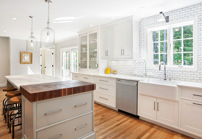 Modern farmhouse kitchen. This modern White farmhouse kitchen features a gray island and a farmhouse sink. #farmhousekitchen #grayisland #Farmhousesink Pennville Custom Cabinetry