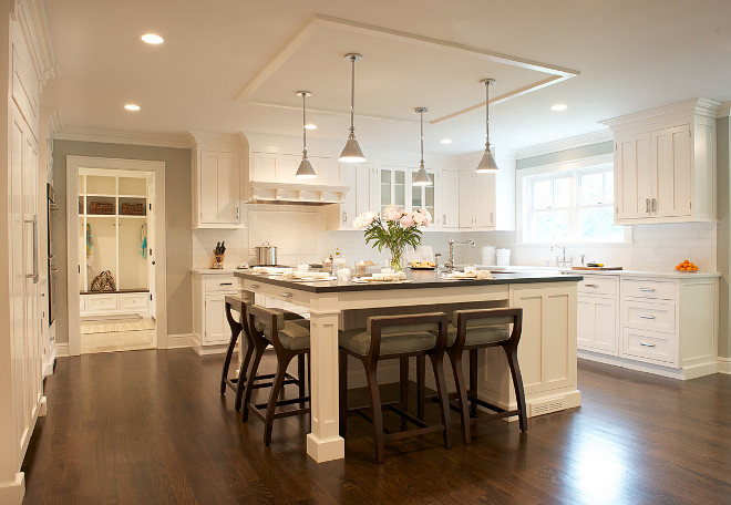 Off white kitchen cabinets with walnut hardwood floors #whitekitchen #offwhitekitchen #wanutfloors #walnutflooring #kitchenwalnutfloor Dalia Canora Design