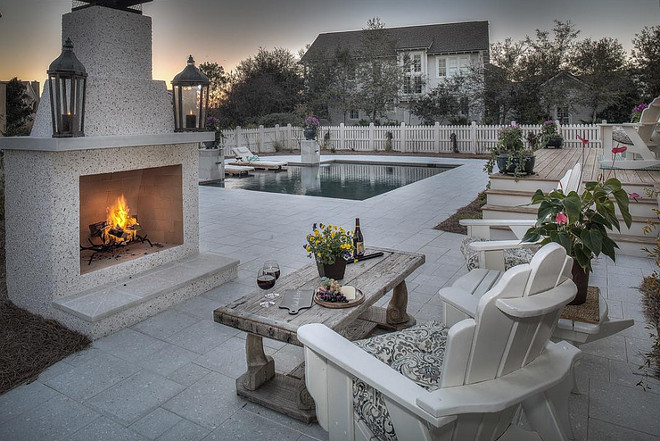 Outdoor fireplace by pool. #outdoorfireplace #pool 30avibe Photography.