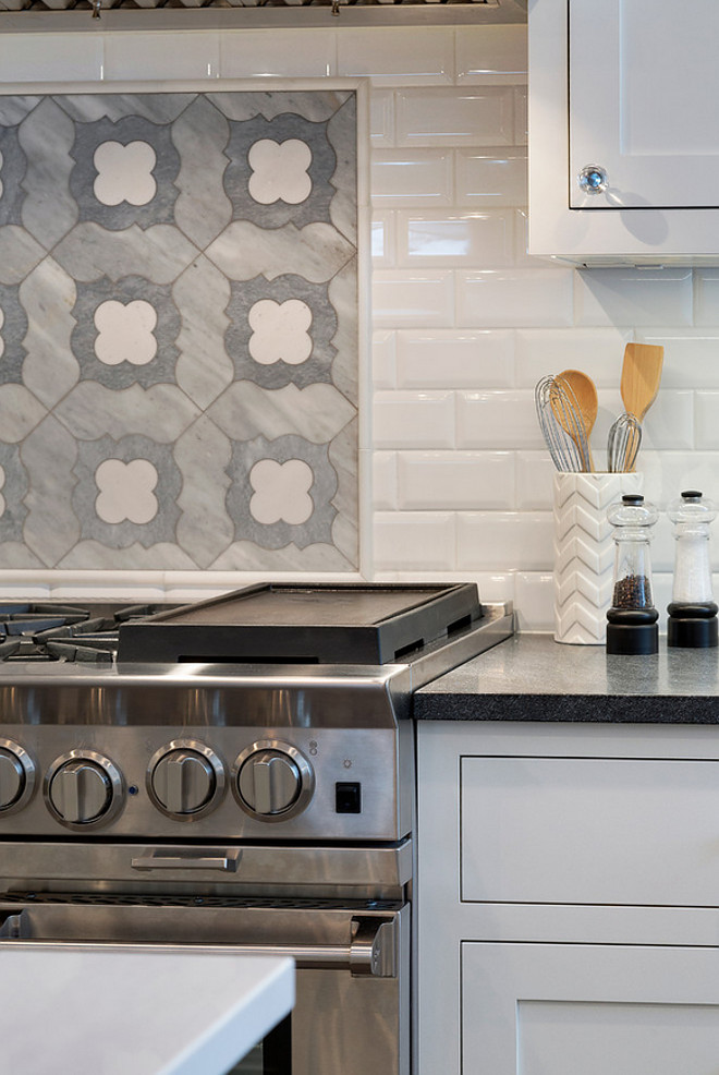 Range accent tile backsplash. The accent tile above the cooktop is a marble mosaic. It is from the Talya Collection Irene PR90051 at MN Tile. #Rangeaccenttilebacksplash Grace Hill Design