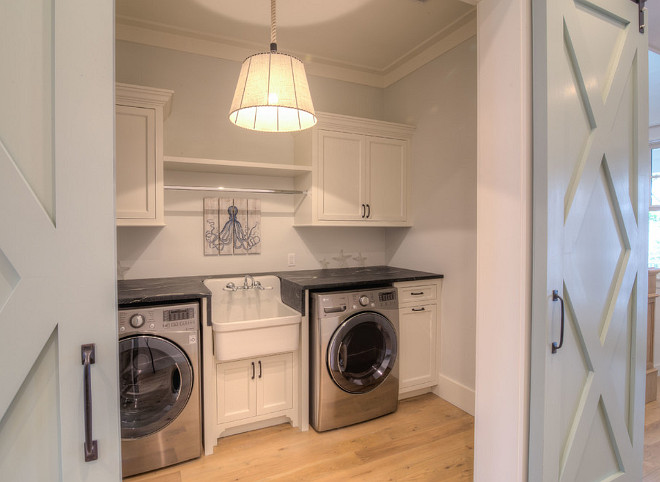 Second Floor Laundry Room with Barn Doors painted in SW 6205 Comfort Gray and sink. #Laundryroom #secondfloorlaundryroom #barndoor #SW6205ComfortGray 30A Interiors