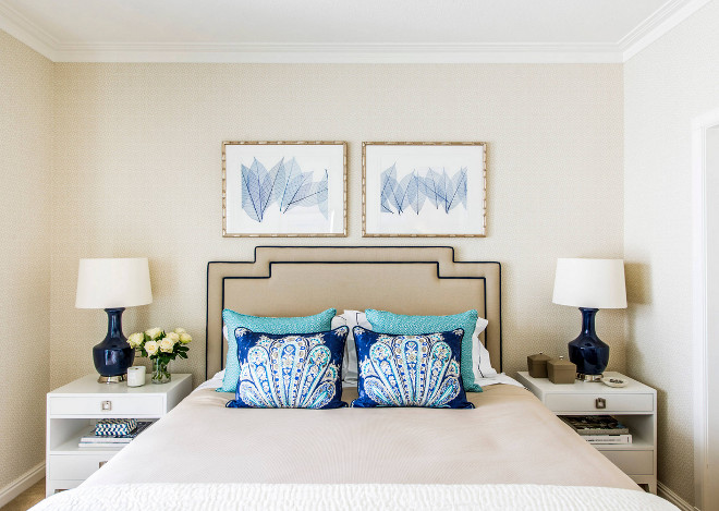 Small Bedroom. Small Bedroom feautures a queen bed, neutral wallpaper, blue and white art above bed and a pair of white nightstands. Small Bedroom Ideas #Smallbedroom Highgate House