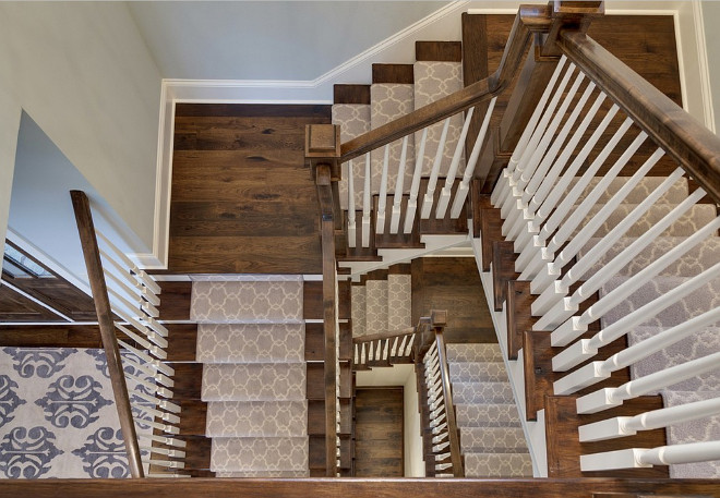 The staircase features a gray Moroccan-style stair runner Stair runner, How to change the look of your stairway with a gray Moroccan-style stair runner #Stairwayrunner Design by Stonewood, LLC.