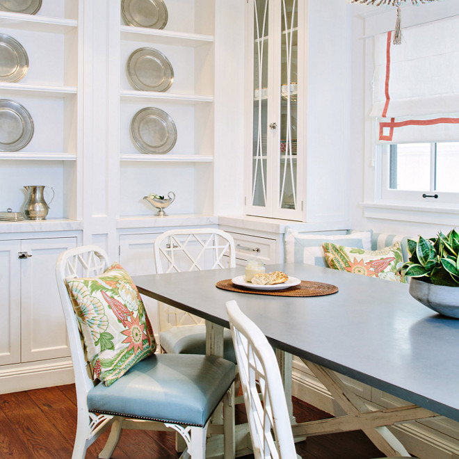 White table with gray top, Breakfast nook features a white distressed table with gray top and white chairs #Whitetable #whitetablegraytop #whitechairs #breakfastnook Waterleaf Interiors
