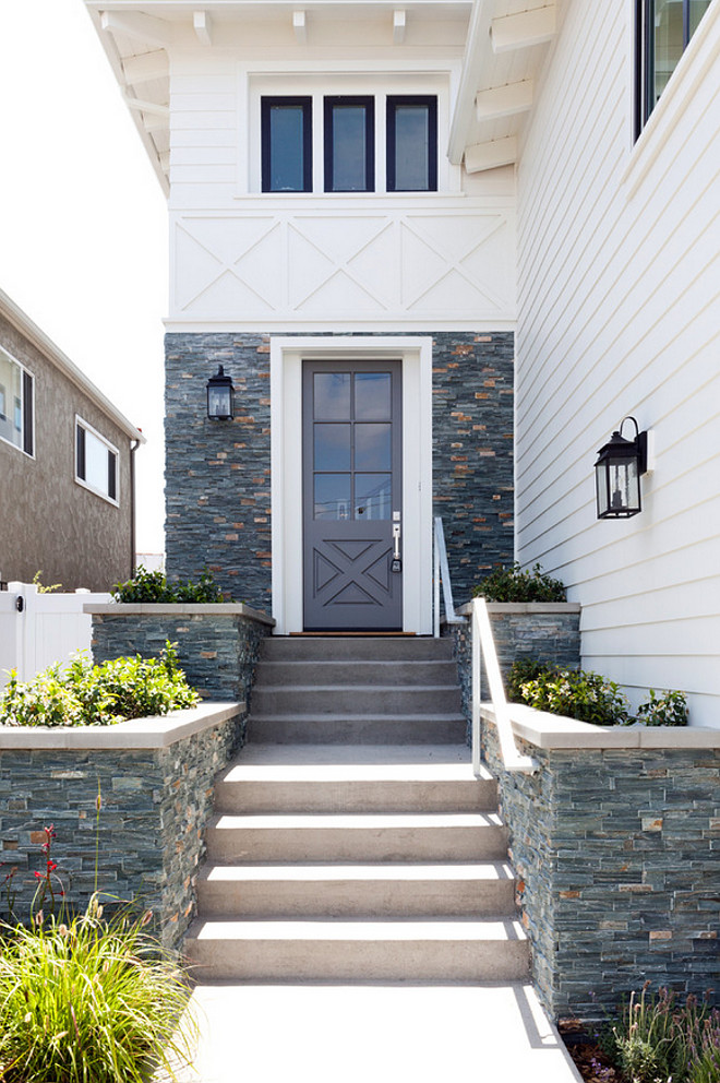 White siding and gray stone exterior. Siding and stone exterior. Siding and stone exterior ideas. Siding and stone exterior pictures. Siding and stone exterior photos and ideas. #Sidingstoneexterior #Sidingstonehomeexterior #Sidingstoneexteriorideas #Sidingexterior #Stoneexterior Kate Lester Interiors