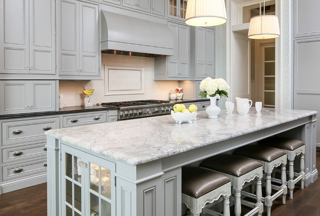 Traditional Gray Kitchen with white quartzite island countertop and soapstone perimeter countertop. #TraditionalKitchen #GrayKitchen #TraditionalGrayKitchen #Whitequartzite #countertop Artisan Signature Homes.