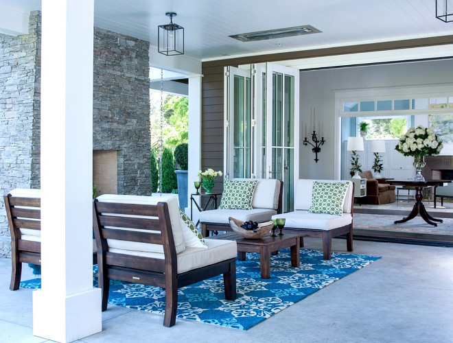 Patio space off the kitchen and the entry. The bi-fold doors open to the entry and the living room giving the client a larger entertaining space when needed. The infra red heaters in the ceiling make this a year round space. Johnston Home LLC