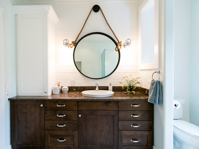 These full overlay maple cabinets are from Brookhaven (a Woodmode product) - the wall cabinet is painted Nordic White and the vanity is finished in their Dark Lager stain. BAC Design Group