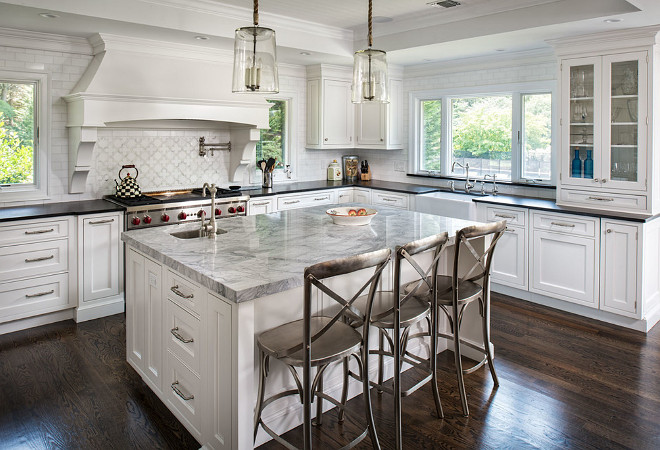 Kitchen island and perimeter countertop ideas. How to choose the right combination of island and perimeter countertop. The island countertop is a Super White Quartzite and the perimeter is a Black Absolute granite with a leathered finish. #KitchenCountertop #Kitchenislandperimetercountertop #Kitchenislandperimetercountertopideas #Kitchenislandperimetercountertopcombination Artista Kitchen & Bath Design