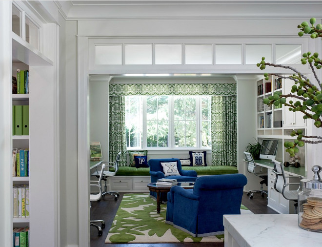 This home office off the kitchen acts as a control center for the family. Kids work on computers in open spaces, not in their rooms. The window seat is a sunbrella velvet for durability and the chairs swivel to 'talk' with the kitchen