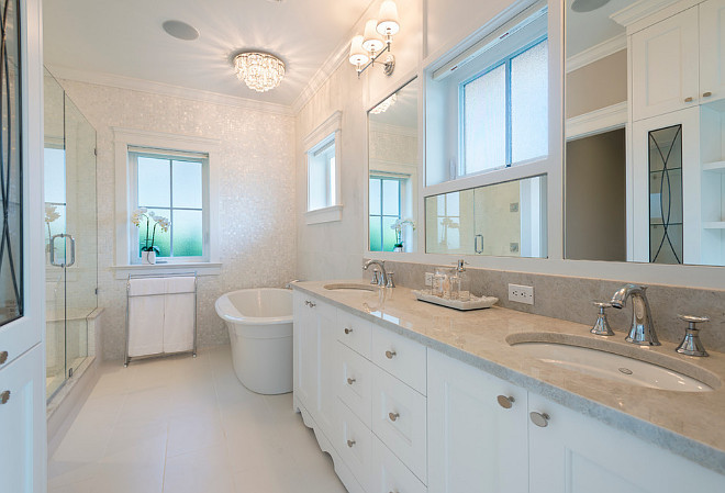 Bathroom. Master Bathroom. Neutral master bathroom. Neutral bathroom with crystal faucet handles and undermounted sinks. #Bathroom #NeutralMasterbathroom #Neutralbathroom Kemp Construction. Sarah Gallop Design Inc.