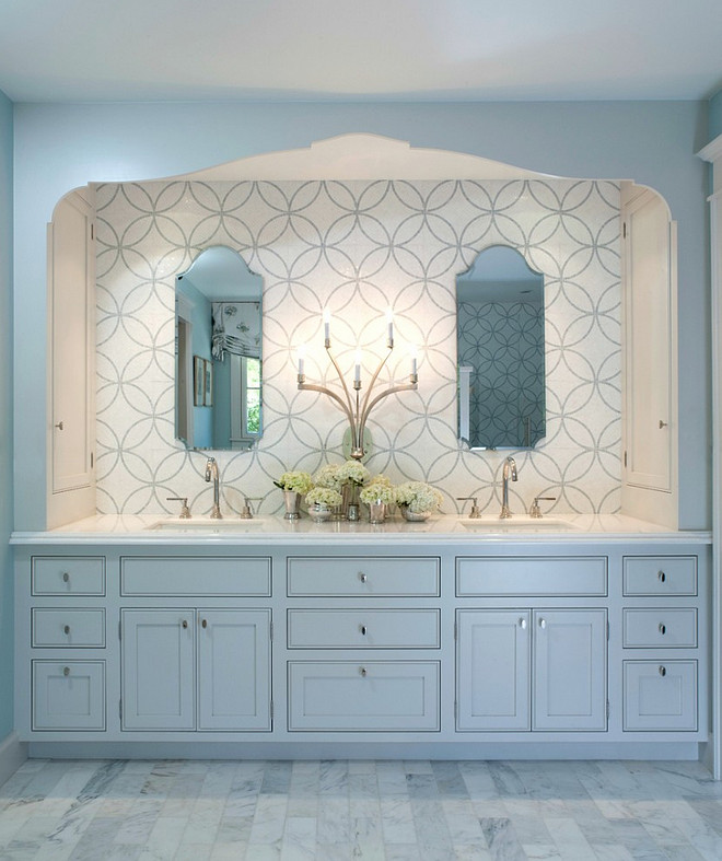 The Master Bath is a peaceful retreat with spa colors. The cabinet and trim are Benjamin Moore Light Pewter.  The woodwork is painted a pale grey to pick up the veining in the marble. The mosaic tile behind the mirrors adds pattern. Built in side cabinets store everyday essentials. #BenjaminMooreLightPewter.  Johnston Home LLC