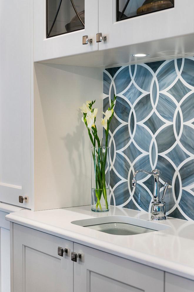 white kitchen with blue gray backsplash