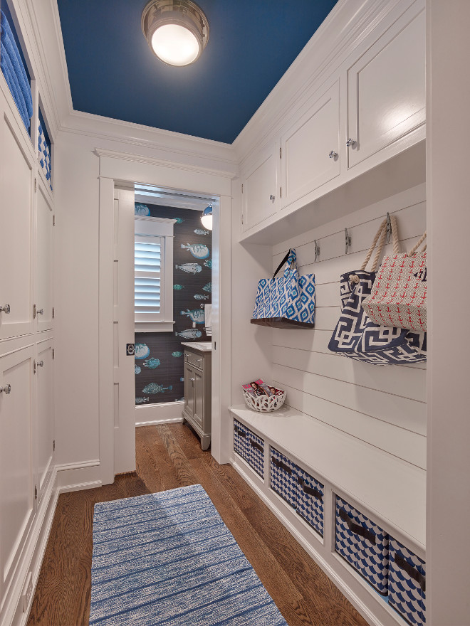 Mudroom Hallway with Cabinets on both walls. This small hallway-style mudroom feature cabinets on both walls. Mudroom Hallway style with Cabinets on both sides of wall. #MudroomHallway #MudroomHallwayCabinet #MudroomCabinets #MudroomWallCabinet Cole and Son 97/10032 Fornasetti II Acquario. Asher Associates Architects. Megan Gorelick Interiors