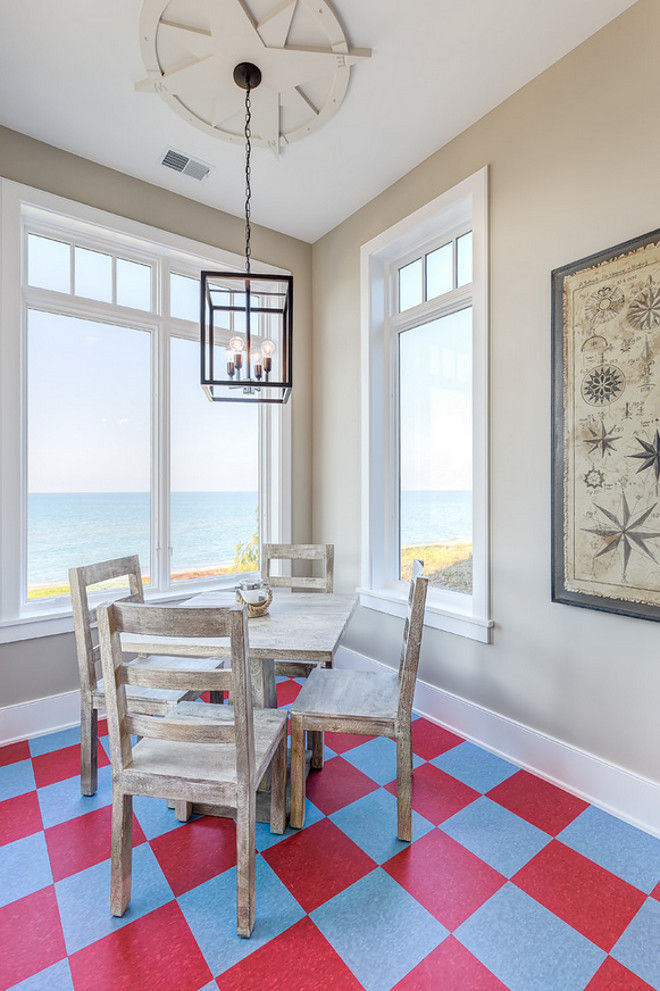 Leading straight to the beach, this cheerful refreshment area boasts checkered floors, industrial lighting and compass-themed coastal décor that sets a playful tone and makes for the perfect spot to watch the sun set over the lake. Mike Schaap Builders