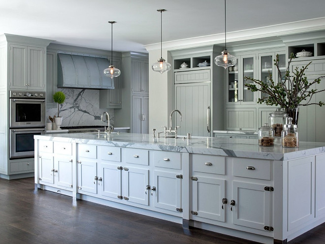 Gray kitchen with white island paint color. The island paint color is Benjamin Simply White and the gray cabinets were a custom color for the job. #Benjaminmooresimplywhite #whiteislandpaintcolors Johnston Home LLC