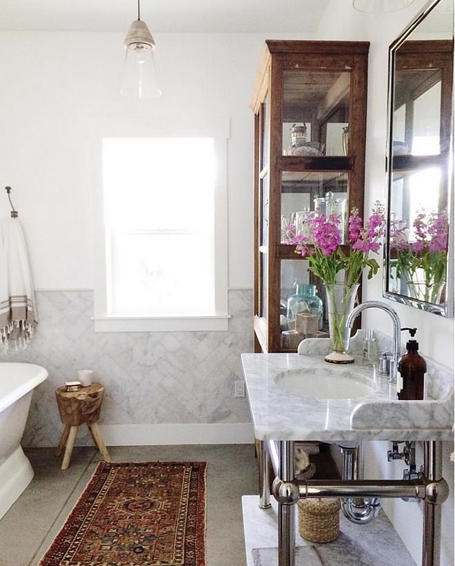 Bathroom Herringbone Wall Tile. Bathroom half wall with Herringbone Tile. Bathroom Marble Herringbone Wall Tile. #BathroomHerringboneWallTile Heather Bullard.