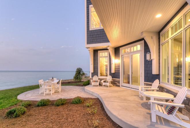 Shingle Beachfront Home with Casual Coastal Interiors ... on Beach House Patio Ideas id=25141