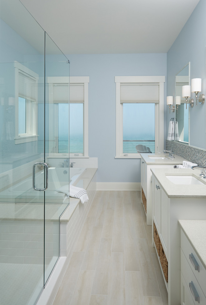 Storybook shingle beach house with coastal interiors Master bathroom tile floor