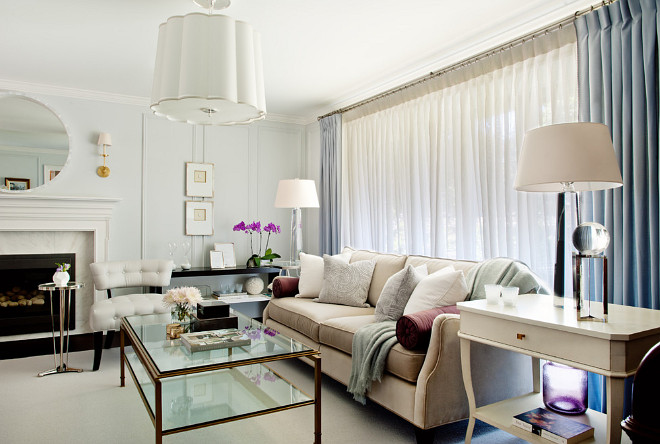 Chic, tailored living room. Custom upholstery with Barbara Barry fabric on accent toss cushions. Large scale lighting fixtures. #Livingroom Elizabeth Metcalfe Interiors & Design Inc.