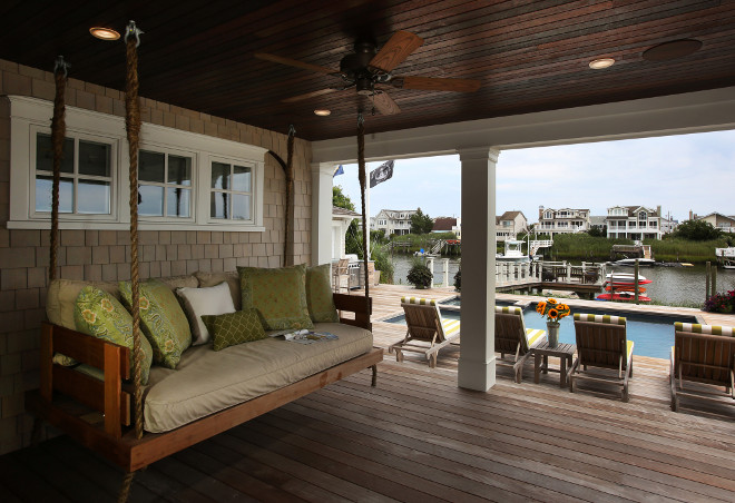 Coastal home with porch swing. Porch swing #Porchswing Asher Associates Architects