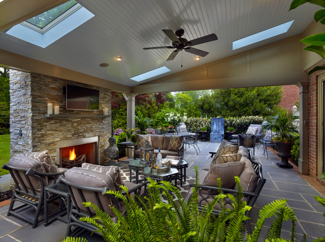 Covered patio with outdoor fireplace #patiofireplace Megan Gorelick Interiors