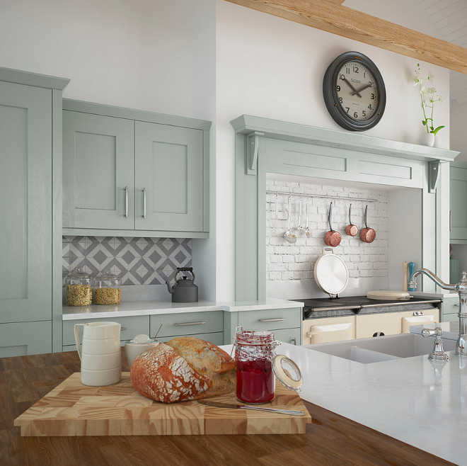 European style kitchen with mint green cabinets. Kitchen Stori.