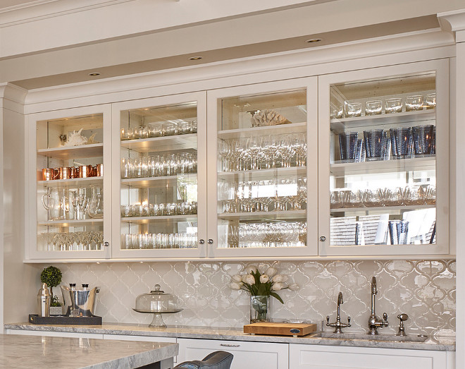 Kitchen Bar Glass Door Cabinet. The kitchen bar features glass cabinet doors with mirrored back and white Arabesque backsplash tile Kitchen Bar Cabinet with Glass Doors and Mirrored Back. #Kitchen #Bar #KitchenBarCabinet #BarCabinet #Cabinetglassdoor Asher Associates Architects. Megan Gorelick Interiors