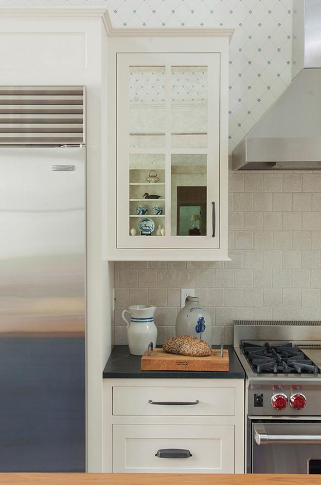 Kitchen cabinet with mirrored doors. Mirror kitchen cabinet doors.  Banks Design Associates