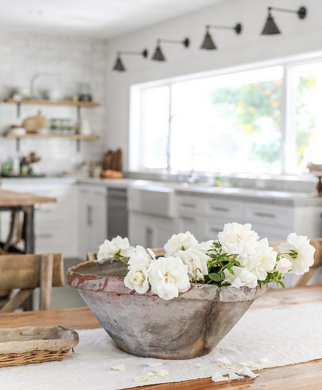 Kitchen decorating ideas. Kitchen sconces are from Restoration Hardware. Heather Bullard.