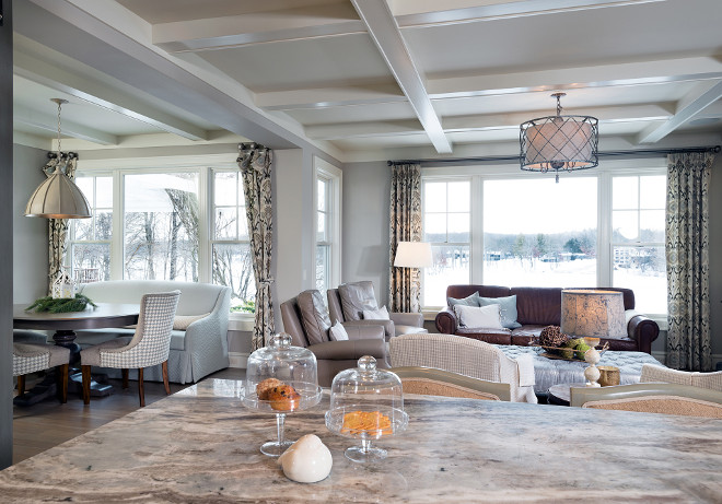 Kitchen opens to breakfast room with a settee and family room with coffered ceilings. #Openlayout #openkitchen #breakfastroom #cofferedceiling #livingroom Mike Schaap Builders